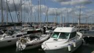 Stock Video Footage of motor boats and yachts at a marina man getting on a boat