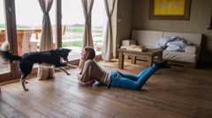 Woman lay on floor and play with dog 4K Stock Footage