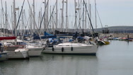 Stock Video Footage of yacht moving into is berth