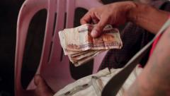 Counting money in Indian banks. Stock Footage