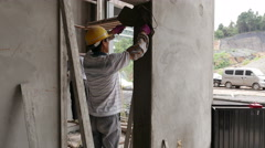 2 Construction Workers Plastering Walls or Wall Flattening - 4K - stock footage