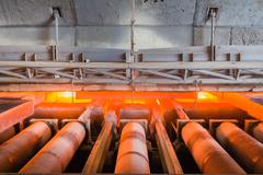 Charging slab in Furnace, In front side Furnace, Industry steel background. Stock Photos