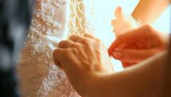Dressing up for wedding ceremony. lacing wedding dress of bride Stock Footage