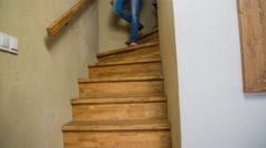 Dog afraid to walk down stairs behind owner 4K Stock Footage
