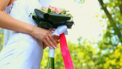 Bride with wedding bouquet of flowers in park. dolly motion Stock Footage