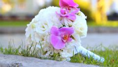 Closeup of wedding bouquet of white roses and purple orchids flowers Stock Footage