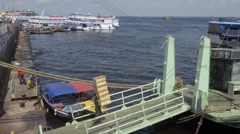 Transport boats moored in the passenger pier of Manaus city Stock Footage