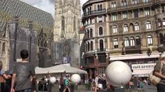 ULTRA HD 4K Crowded Stephansplatz public square Vienna Stephens Cathedral emblem Stock Footage