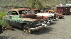 Old wrecks, cars 1950s detail, wide shot, rust and patina Stock Footage