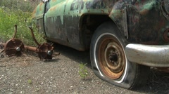 Old wrecks, cars 1950s detail, pan reveal, rust and patina Stock Footage