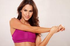 Happy tan latina fitness woman horizontal portrait - stock photo