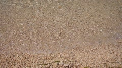 Rocky Beach Pebbles Waves Lapping Simple Water Sea Stock Footage