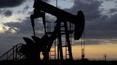 petroleum pumpjack silhouette - stock footage
