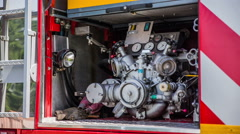Firetruck water pump in the back of vehicle Stock Footage