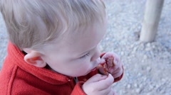 Toddler eating bacon while camping Stock Footage