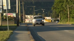 Chilliwack, small town morning traffic billboards handheld Stock Footage
