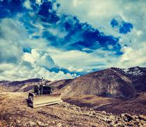Bulldozer on road in Himalayas - stock photo