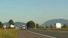 Three different transport rucks on the highway, lower mainland, med shot Stock Footage