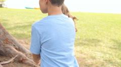 Two Children On Easter Egg Hunt In Garden Stock Footage