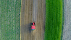 Ascending over tractor plowing own soil 4K Stock Footage