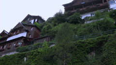 Traditional houses in Hallstatt mountain alps village Stock Footage