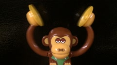 Toy Monkey Clashing Cymbals Overhead Stock Footage