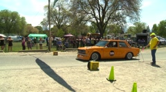 motorsports, hillclimb launch orange Datsun 510 - stock footage