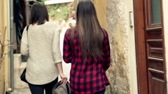Two girlfriends walking, sightseeing old greek city HD - stock footage