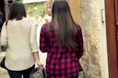 Two girlfriends walking, sightseeing old greek city NTSC Stock Footage
