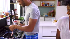 Young Couple Cooking Breakfast In Kitchen Together Stock Footage