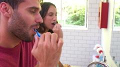 Couple In Pajamas Brushing Teeth In Bathroom Stock Footage