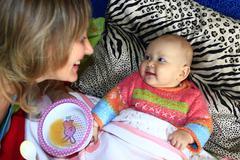 nursing of little baby - stock photo
