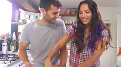Young Couple Making Pizza In Kitchen Together Stock Footage