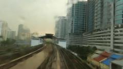 LRT train departure from station, view within tail cabin, through rainy glass Stock Footage