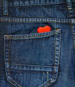 Red heart in a back pocket of a jeans - stock photo