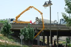 Construction under a bridge - concrete pump - stock photo
