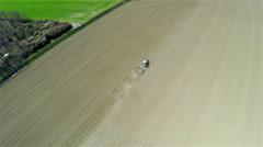 AERIAL: Tractor preparing soil for seeding 4K Stock Footage
