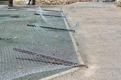 Smashed fence - stock photo
