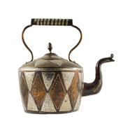 Stock Photo of Authentic metal teapot vessel isolated