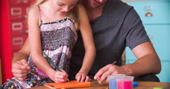 Father And Daughter Coloring Picture In Child's Bedroom Stock Footage