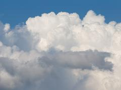 Fluffy white cumulus clouds Stock Photos