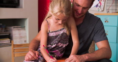 Father And Daughter Practicing Handwriting In Bedroom - stock footage