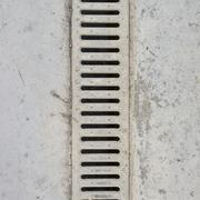 Drain grate in concrete floor Stock Photos