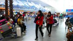Airport hall, camera move to check-in counters area, glide shot, passengers Stock Footage