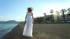 Women in the hat on the beach of Marmaris, Turkey. RAW video record Stock Footage