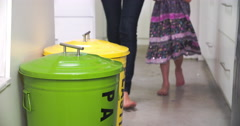 Mother And Daughter Putting Recycling Into Bins Stock Footage