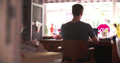 Rear View Of Couple Running Business From Home Office Stock Footage