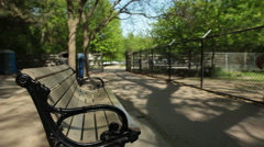Man Walks By Park Bench - stock footage