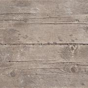 Old threadbare wooden surface - stock photo