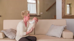 Mother hold baby in hand in big retro living room 4K Stock Footage
